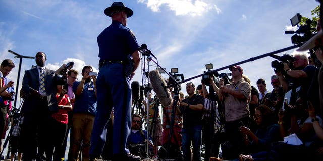 Michigan State Police spokesman Lt. Dave Kaiser speaks to media at Bishop International Airport in Flint, Mich., Wednesday, June 21, 2017, after a police officer was stabbed at the airport.