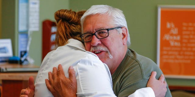 IMAGE DISTRIBUTED FOR ASPEN DENTAL - Veteran Clarence Tabat gives Samantha Cox, DDS a hug after his treatment at the Aspen Dental office in Brookfield on Saturday, June 24, 2017, in Brookfield, Wis. (Tom Lynn/AP Images for Aspen Dental)