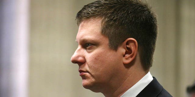 Chicago police officer Jason Van Dyke, who is charged in the 2014 shooting death of black teenager Laquan McDonald, appears at a hearing in his case at the Leighton Criminal Courts Building in Chicago.