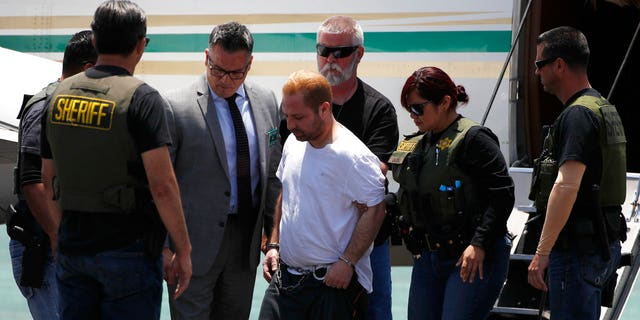 Aramazd Andressian, Sr., center, escorted off a plane in June to face a murder charge.