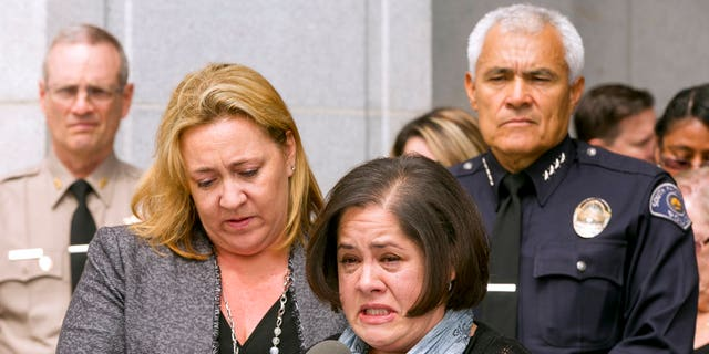 Ana Estevez, center, the mother of Aramazd Andressian Jr., tearfully addressed reporters on May 17, 2017.