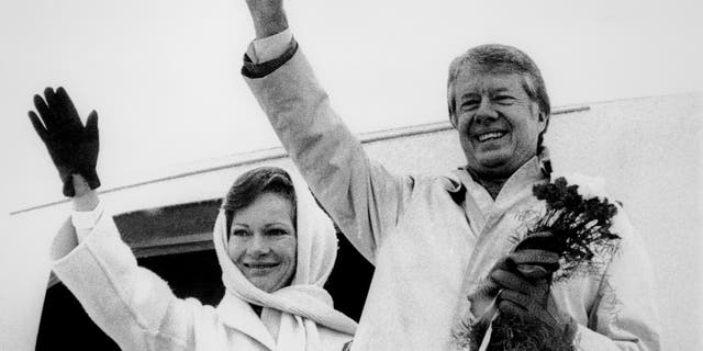 FILE - In this Dec. 31,1977, file picture, President Jimmy Carter and his wife  Rosalynn Carter wave goodbye before their departure from Warsaw, Poland, first stop of their trip through seven countries. When President Donald Trump arrives in Warsaw, on Wednesday, July 5, 2017, with his wife Melania, he will be the eight U.S. president to visit Poland, a Central European nation that peacefully shed Moscow's dominance in 1989, joined NATO in 1999 and the European Union in 2004, and which is one of the staunchest U.S. allies in Europe. (AP Photo, File)
