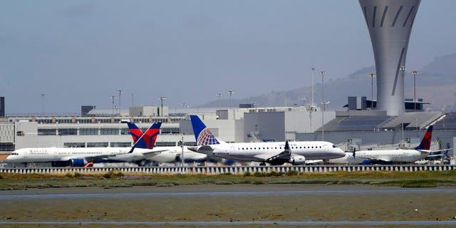 July 11, 2017: Departing and parked aircraft intersect at San Francisco International Airport.