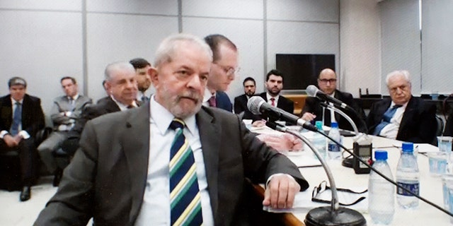 This screen grab of a video recorded on May 10, 2017, released by the Parana Federal Justice department, shows Brazil's former President Luiz Inacio Lula da Silva testifying in the Car Wash investigation in Curitiba, Brazil. A federal judge convicted the ex-president of corruption and money laundering on Wednesday, July 12, 2017 and sentenced him to nine and a half years in jail. Silva will remain free while an appeal is heard. (Parana Federal Justice department via AP)