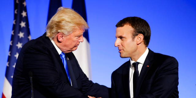 President Donald Trump, left, shaking hands with French President Emmanuel Macron at the Elysee Palace in Paris, in July.
