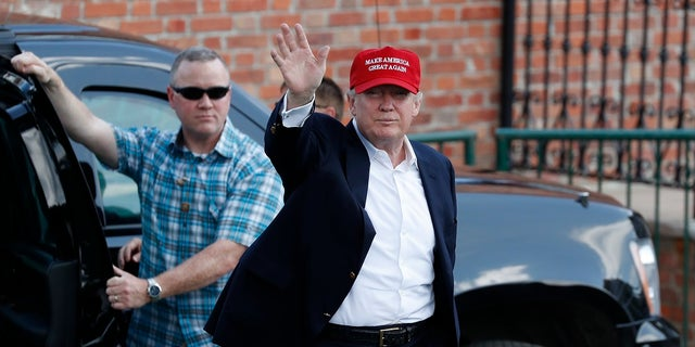 President Donald Trump arrives to enter his presidential viewing stand Saturday, July 15, 2017, during the U.S. Women's Open Golf tournament at Trump National Golf Club in Bedminster, N.J.