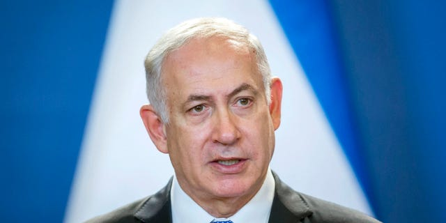 Staying on a four-day official visit in Hungary, Israeli Prime Minister Benjamin Netanyahu speaks during his joint press conference with his Hungarian counterpart Viktor Orban in the Parliament building in Budapest, Hungary, Tuesday, July 18, 2017. (Balazs Mohai/MTI via AP)