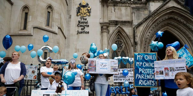 Supporters of critically ill baby Charlie Gard shout and hold placards.