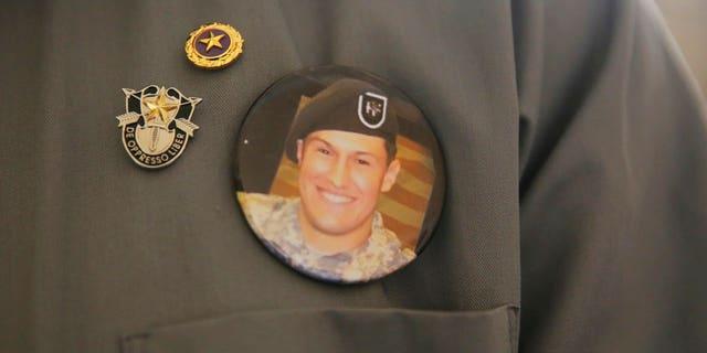 A badge with a photo of Sgt. Matthew Lewellen, a slain U.S. Army Green Beret.