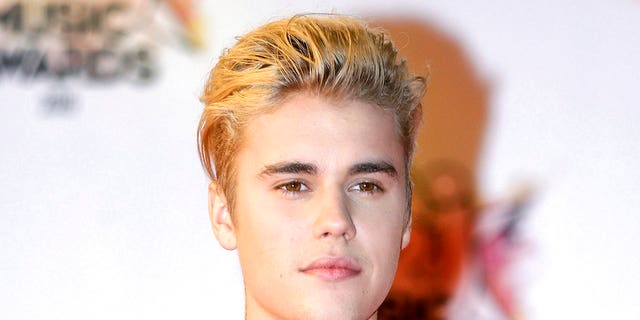 FILE - In this Nov. 7, 2015 file photo, Justin Bieber arrives at the Cannes festival palace in Cannes, southeastern France. Police say Bieber has accidentally struck a photographer with his pickup truck Wednesday night in Beverly Hills. (AP Photo/Lionel Cironneau, File)