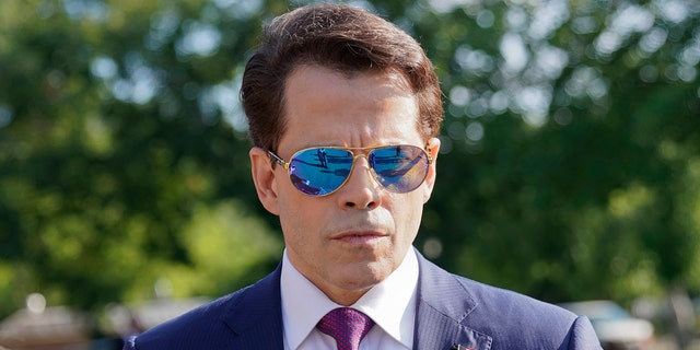 In this July 25, 2017, photo, White House communications director Anthony Scaramucci walks back to the West Wing of the White House in Washington. Six months into presidency, Donald Trump is saddled with a stalled agenda, a West Wing that resembles a viper's nest, a cloud of investigations and a Republican Party that is starting to break away.