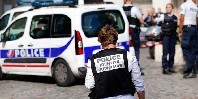 French police work on the scene of an attack that injured six soldiers.