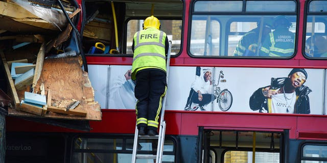 A red double-decker bus crashed into a London shop on Thursday.