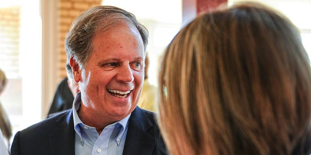 Senate candidate Doug Jones chats with constituents before a forum in Decatur, Ala.