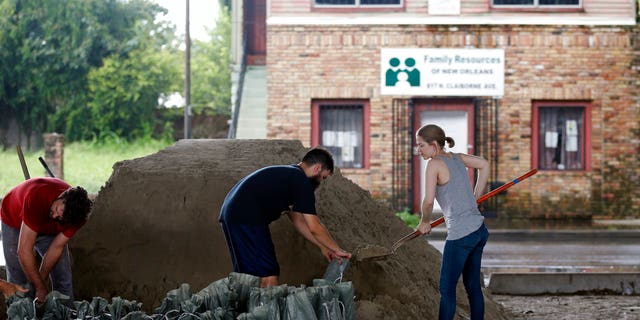 New Orleans residents fill more sandbags for potential more flooding from rain storms on Aug. 11.