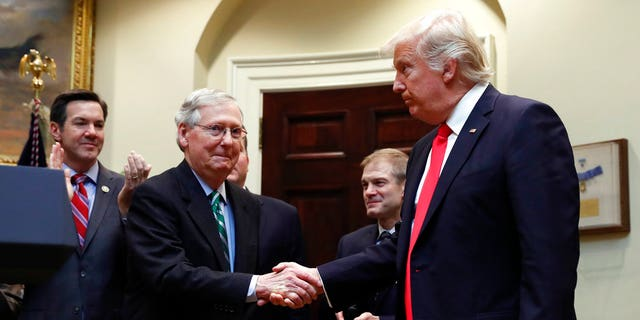 In this Feb. 16, 2017, file photo, President Donald Trump shakes hands with Senate Majority Leader Mitch McConnell of Ky., during a ceremony in the Roosevelt Room of the White House.