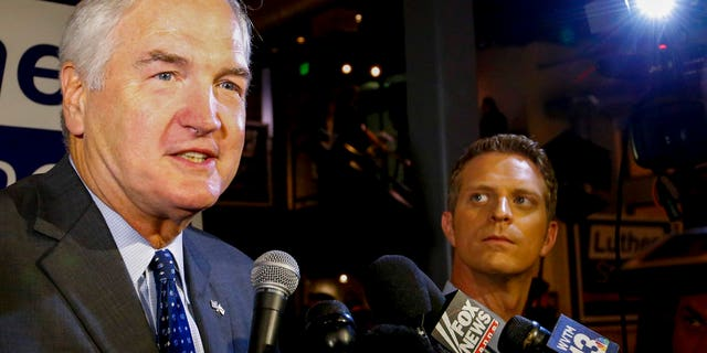 Sen. Luther Strange speaks to media after forcing a runoff against former Chief Justice Roy Moore, Tuesday, Aug. 15, 2017, in Homewood, Ala. (AP Photo/Butch Dill)