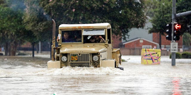 A truck pushes through floodwaters in Houston, Texas.