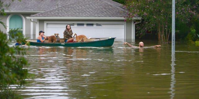 A family evacuates their Meyerland home in Houston, Texas.