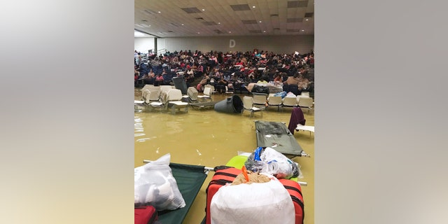 Evacuees sit in the bleachers at the Bowers Civic Center in Port Arthur.