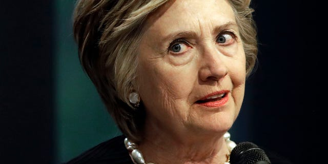 """In this June 5, 2017 photo, former Secretary of State Hillary Clinton speaks at a fundraiser for the Elijah Cummings Youth Program in Israel in Baltimore. The FBI's Hillary Clinton email investigation that ended without charges remains a lingering grievance for President Donald Trump, who holds it up as an example of a """"rigged"""" system. (AP Photo/Patrick Semansky)"""