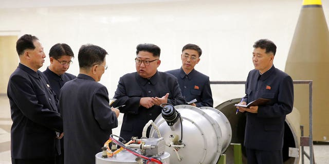 North Korean leader Kim Jong Un inspecting the loading of a hydrogen bomb into a new intercontinental ballistic missile.