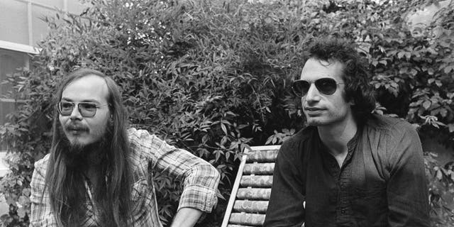 FILE - In this Oct. 29, 1977, file photo, Walter Becker, left, and Donald Fagen of Steely Dan, sit in Los Angeles. Becker, the guitarist, bassist and co-founder of the rock group Steely Dan, has died. He was 67. His official website announced his death Sunday, Sept. 3, 2017, with no further details. (AP Photo/Nick Ut, File)