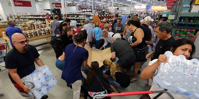 Residents purchase water at BJ Wholesale in preparation for Hurricane Irma Tuesday, Sept. 5, 2017, in Miami.