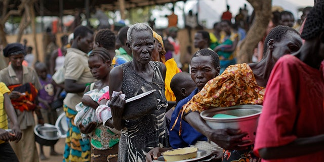 People line up for food in northern Uganda.