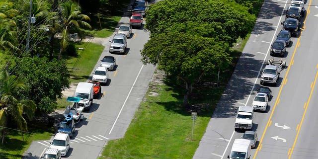 Motorists head north on Highway US 1, in Tavernier, Fla., Sept. 6, 2017