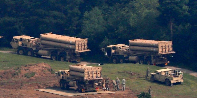 U.S. missile defense system called Terminal High-Altitude Area Defense system, or THAAD, are seen at a golf course in Seongju, South Korea.