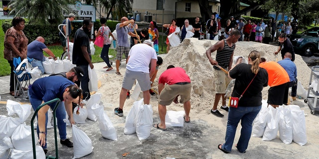 Residents line up at Frost Park in Dania Beach, Fla., and fill up sandbags in preparation of Hurricane Irma in Dania Beach, Fla., on Thursday, Sept. 7, 2017.