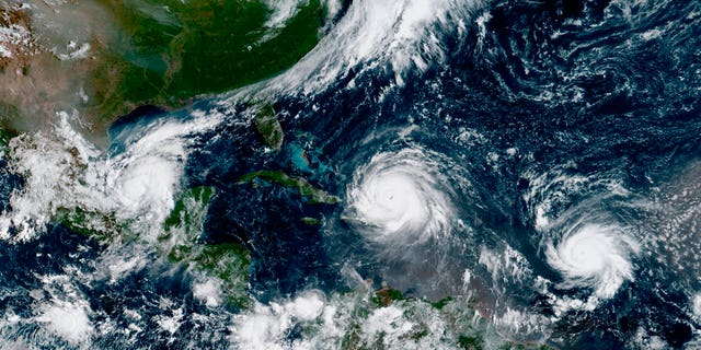 Satellite image taken Sept. 7 shows the eye of Hurricane Irma, center, with Hurricane Katie in the Gulf of Mexico, left, and Hurricane Jose in the Atlantic Ocean, right.