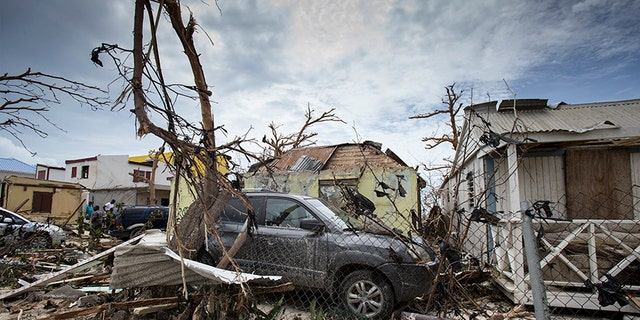 Storm damage, including destroyed vehicles, in the aftermath of Hurricane Irma on St. Maarten.