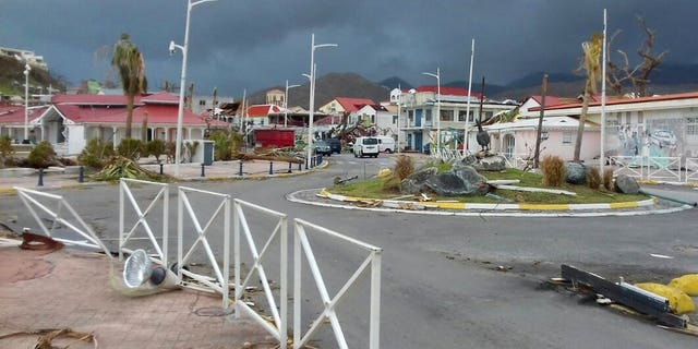 Debris covers the sidewalks of an empty downtown Marigot, on the island of St. Martin