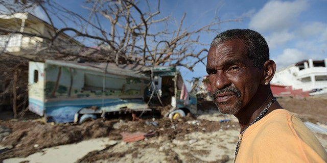 Juan Antonio Higuey shows his destroyed home at Cold Bay community after the passage of Hurricane Irma, in St. Martin.