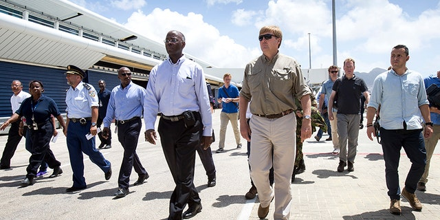 Dutch King Willem-Alexander, center right, visiting after the passing of Hurricane Irma on St. Maarten.