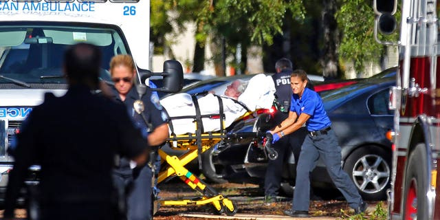 A woman is transported from The Rehabilitation Center at Hollywood Hills on Wednesday, Sept. 13, 2017.