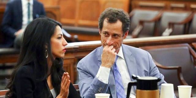 Anthony Weiner, right, and Huma Abedin appear in court in New York on Wednesday, Sept. 13, 2017. The couple asked a New York City judge for privacy in their divorce case. (Jefferson Siegel/The Daily News via AP, Pool)