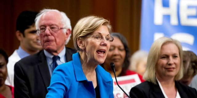 Sen. Elizabeth Warren, D-Mass., speaks in support of Sanders' Medicare for All legislation.