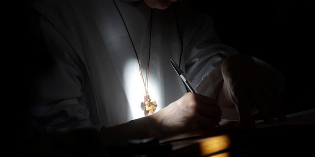 A nun takes notes as she attends a conference on the Latin Mass at Pontifical University of St. Thomas Aquinas in Rome, Thursday, Sept. 14, 2017. (AP Photo/Gregorio Borgia)
