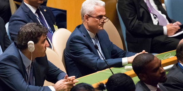 Members of the Iranian delegation listen as President Donald Trump speaks during the United Nations General Assembly in New York.