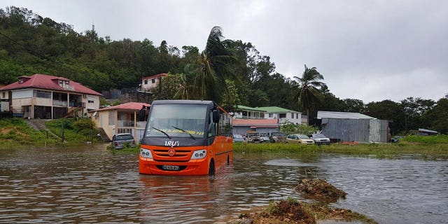 This photo provided by Frank Phazian shows flooding caused by Hurricane Maria near Le Raizet, Guadeloupe, Tuesday, Sept. 19, 2017. (Frank Phazian via AP)