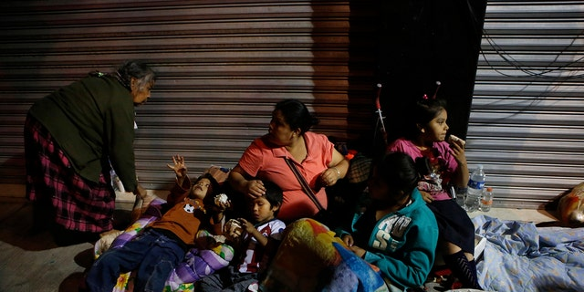 Families fearing aftershocks prepare to sleep on the street in the Roma neighborhood of Mexico City on Tuesday.