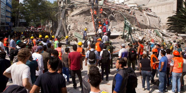 Volunteers and first responders look for survivors in a collapsed building after an earthquake struck Mexico City on Tuesday.
