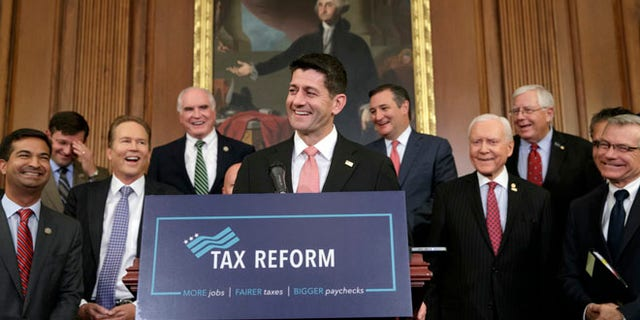 Speaker of the House Paul Ryan, R-Wis., smiles as he talks about the Republicans' proposed rewrite of the tax code for individuals and corporations, at the Capitol in Washington, Wednesday, Sept. 27, 2017. President Donald Trump and congressional Republicans are writing a far-reaching, $5-trillion plan they say would simplify the tax system and nearly double the standard deduction used by most Americans. (AP Photo/J. Scott Applewhite)