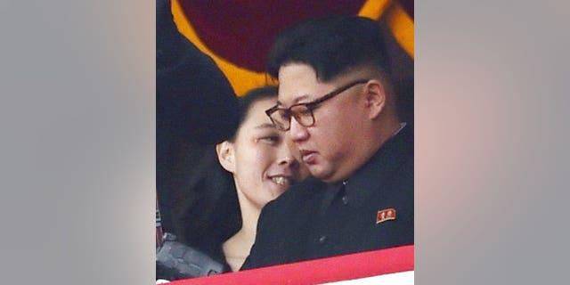 North Korean leader Kim Jong Un and his sister Kim Yo Jong watch a military parade at Kim Il Sung Square in Pyongyang.