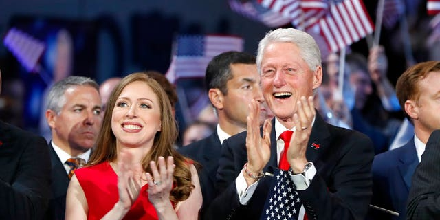In this July 28, 2016 file photo, Chelsea Clinton and former President Bill Clinton applaud as Hillary Clinton speaks during the final day of the Democratic National Convention in Philadelphia. Allegations have resurfaced of questionable donations to the Clinton Foundation.