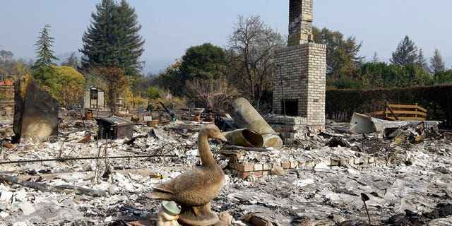 Remains of a home destroyed by wildfires is seen on Wednesday, Oct. 18, 2017, in Glen Ellen, Calif. California fire officials have reported significant progress on containing wildfires that have ravaged parts of Northern California. (AP Photo/Ben Margot)