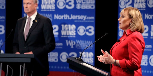 In New Jersey, Trump has not spoken out in support of Republican Lt. Gov. Kim Guadagno (right), who is running against Democratic nominee Phil Murphy (left).